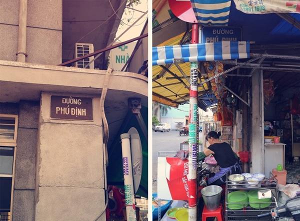 Ở đầu đường Phú Định giao Lương Nhữ Học có hai bảng tên đường đối diện nhau, một bảng có vẻ khá lâu đời và một bảng mới nhưng bị che khuất bởi mái hiên của một tiệm bánh xèo khá ngon.