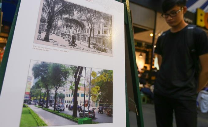 """Góc đường Đồng Khởi - Lê Thánh Tôn qua ảnh chụp năm 1920 với tòa nhà Catinat, từng là Đại sứ quán của Bồ Đào Nha, Áo, Tây Ban Nha. Sau năm 1975, tòa nhà là chung cư cho đến năm 2014 thì bị phá bỏ để làm phần mở rộng của UBND TP HCM. """"Em xem kỹ từng bức ảnh, nhìn thật lâu để so sánh sự thay đổi của thành phố. Nhờ triển lãm mà em có thêm nhiều kiến thức thú vị về Sài Gòn"""", bạn Minh Nhật (20 tuổi) chia sẻ."""