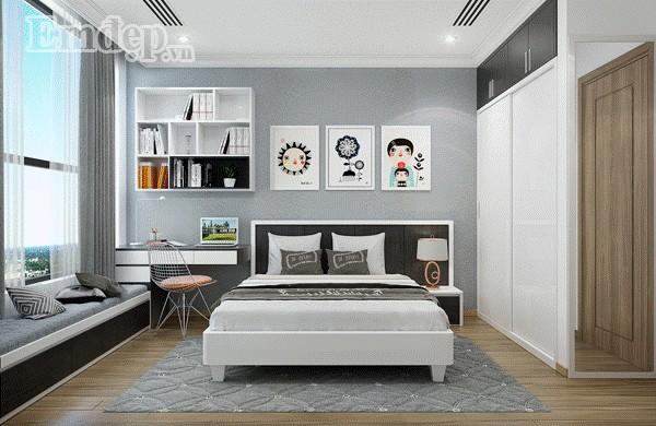 Phòng ngủ của cô con gái đầu sinh động, trẻ trung, tràn đầy năng lượng với những bức tranh tô điểm vui tươi.