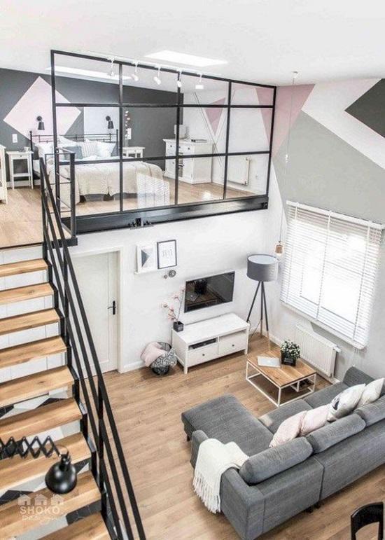 Với căn hộ nhỏ, việc phân chia các khu vực chức năng sẽ dễ dàng hơn khi thiết kế thêm gác lửng phía trên, tăng thêm diện tích sử dụng cũng như sự rộng thoáng khi bố trí nội thất.