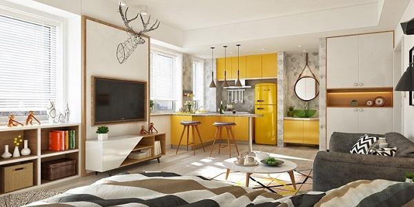 Tủ bếp trên, tủ bếp dưới, tủ lạnh, bồn rửa tay đều mang một sắc vàng rực rỡ.